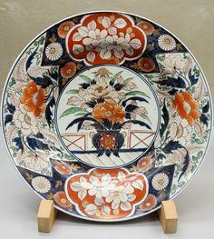Dish, Imari ware, Edo period, 18th century, flowering plant design in underglaze blue and overglaze enamel - Tokyo National Museum