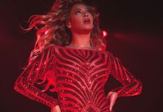 Beyonce performs in beaded body suit by Marc Bouwer
