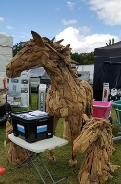 Suppliers of an exceptional driftwood horse, driftwood horse heads plus other driftwood sculptures and furniture.