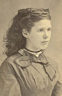 A young girl wearing a bandeau type hair comb, 1860s