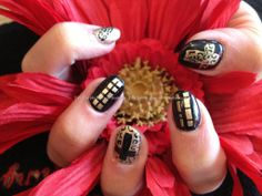 Black and gold, leopard, cross and abstract freehand nail art on acrylic nails