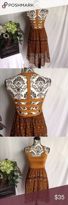 NWT Rust Caged/Cutout Back Dress Small. New with tags. Caged and cutout back. Lined. Free gift. No flaws. Dresses Midi
