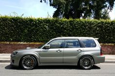 Perfection. Jic magic suspension. The tires are 265-35-18. The wheels are enkei nt03+m and the color is sbc.