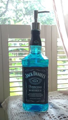 Jack Daniels Glass Bottle mouthwash dispenser for the mens bathroom ;-)