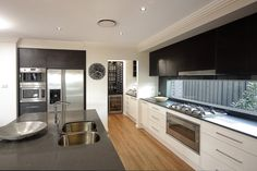 Love the cupboards, handles and glass splash back Kitchen Designs with Butler Pantries