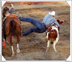 Rodeo; bull dogging