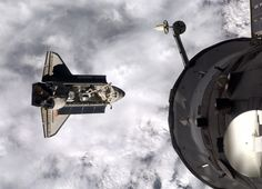 """Endeavour Approaches the International Space Station - Astronaut Ron Garan, aboard the International Space Station, tweeted (as @Astro_Ron): """"#Endeavour after doing a """"flip"""" prior to today's docking. Great 2 have #STS134 crew on board! #FromSpace #NASA,"""" on May 18, 2011 (Flight Day 3)."""