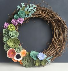 This Felt Succulent & Flower Grapevine Wreath is the perfect way to dress up your door or wall. Felt flowers and varied green succulents frame it.