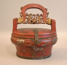 Antique lunchbox! I'm just trying to imagine what person or child would USE this...it would seem like a child wealthy enough to have this would be schooled at home. Maybe it was a picnic basket.