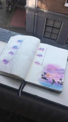 Islands and dolphin made with watercolor, bullet journal weekly spread