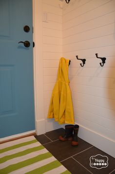 Laundry Mud Room revamp horizontal white paneling with hooks and turqouise chalk paint door at thehappyhousie