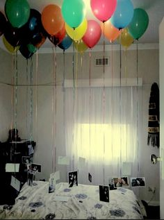 Great idea for hanging photos in a 2 hour photography show- hang photos by tying them to balloons