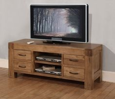 Santana Reclaimed Oak TV Unit with 4 Drawers. £425.99    This rustic and characterful range of furniture is made using reclaimed oak. It has a wonderful deep patina finish which brings out the grain of this lovely old timber. It is very solid, chunky furniture which will look great in a Thames side penthouse or C17th country cottage. It is finished off with attractive metal handles. See its sister range the Brooklyn collection which is more traditional.