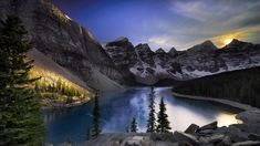 Moraine Lake in Banff National Park Alberta Canada - photo by Michael Lim Lac Moraine, Moraine Lake, Alberta Canada, Banff Alberta, Forest Mural, Pine Trees Forest, Church Pictures, Mystical Forest, Sun And Clouds