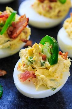 Jalapeno Popper Deviled Eggs are flavored with cream cheese, jalapenos, and bacon and make a fantastic appetizer for Easter.   Deviled Eggs are one of my very favorite foods. It's hard to resist that creamy center and food is so much more fun when you can pick it up and eat it with your fingers. […] The post Jalapeno Popper Deviled Eggs appeared first on Spicy Southern Kitchen. :: Food