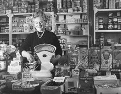 Woman working in corner shop. In the old days your gran or mum would… Ddr Museum, Retro, British History, Uk History, Primary History, Old London, My Childhood Memories, Black And White Pictures, My Memory