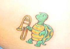 Cartoon Turtle With Trombone Tattoo