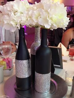 Black chalkboard paint and silver glitter centerpieces made from wine bottles (Bottle Lights Centerpieces) Glitter Centerpieces, Wine Bottle Centerpieces, Silver Centerpiece, Wedding Centerpieces, Wedding Decorations, Centerpiece Ideas, Black And Gold Centerpieces, Black Chalkboard Paint, Decoration Chic