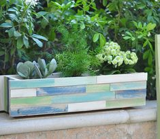 DIY Wood Shim Window Box    Window boxes are great for adding plant life in small spaces. But what if your planter is DOA (dull on arrival)? Here's a project from Kate over at Centsational Girl where she creates a custom look for her standard issue window box, in under 2 hours.