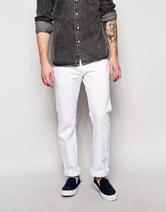 """Jeans by Levi's Non-stretch denim Button fly Slight tapered hem Leg opening: 41cm/16"""" Straight fit - cut with a straight leg Machine wash 100% Cotton Our model wears a 81cm/32"""" regular and is 185.5cm/6'1"""" tall"""