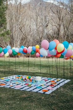 Attach Balloons to Stacks for Outdoor Party from The House That Lars Built and other great party ideas and party decor!