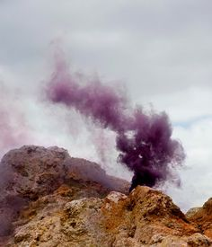 purple smoke rises from the rocky earth, part of the 'nebula humilis' series by lola querrera
