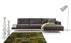 Sofa with large chaise longue and a box