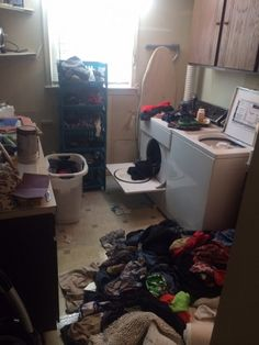 Outdated appliances, peel-n-stick floor, & lots of clothing clutter!