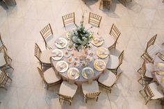 Gold and White Wedding Reception Table Layout with Elegant White Centerpieces | St. Pete Museum of Fine Arts