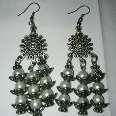 Dangle earrings Costume Jewelry. There are no markings for silver or gold this item may contain nickel or other commonly used metals in costume jewelry the jewelry items on this page will be packaged in bags not boxes. And sealed safely for transport. Jewelry Earrings