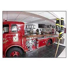 Hose bed of fire truck = bar  Front of fire truck = entertainment center :) My husband would diiiieeee