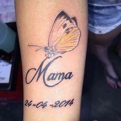 Vlinder op onderarm
