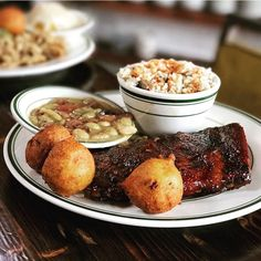 Pit smoked ribs - brown sugar rub, spicy red sauce, pickles, hush puppies, limas and butter beans, and chicken bog.  See this Instagram photo by @buxtonhallbbq • 68 likes