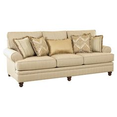 An elegant addition to your living room or den, this classic sofa showcases roll arms and turned bun feet. Made in the USA.   Produc...