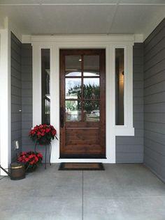 Gray house with wood door.