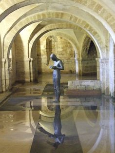 """Winchester Cathedral - The crypt, which frequently floods, houses a statue by Antony Gormley, called """"Sound II"""", installed in and a modern shrine to Saint Swithun. The mysterious statue contemplates the water held in cupped hands. Antony Gormley Sculptures, Photo D Art, Water Art, Public Art, Installation Art, Sculpture Art, Photos, Statue, Winchester"""