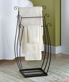 "3-Tier Metal Towel/Quilt Rack. Small ""footprint"" and could hold quite a bit, I think."