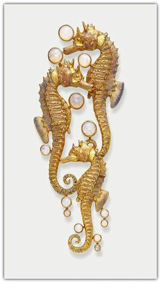 RENÉ LALIQUE | AN UNUSUAL ART NOUVEAU OPAL AND ENAMEL BROOCH - Comprising three sculpted opalescent enamelled sea horses, enhanced by effervescing cabochon opal bubbles, mounted in gold, circa 1900.