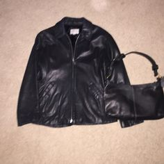 Leather fitted Jacket Beautiful Nine West Lamb Leather Jacket. Worn but in great condition inside and out. Slight discoloration on top of collar back. Not even noticeable. Very well taken care of. Size Med. blk very soft. Zip front, lined. Nine West Jackets & Coats