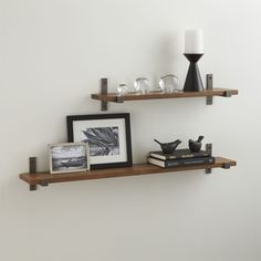 A pair of square cold-rolled steel brackets lend the look of iron and clean-styled, metallic counterpoint to the rustic look of the coordinating Styles wood shelf, crafted from richly colored, reclaimed alder wood. Styles provides a mixed-media approach to contemporary shelving. Choose your favorite combination of square steel brackets in three metallic finishes with marble, glass and reclaimed wood shelves.<br /><br /><NEWTAG/><ul><li>Solid cold-rolled steel</li><li>Reclaimed alder wood…