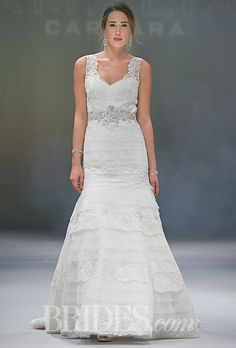 Brides.com: Eve of Milady - Fall 2014. Style 1526, ivory lace and tulle A-line wedding dress with bodice with tiered skirt, v-neck bodice, and a hand beaded belt, Eve of Milady