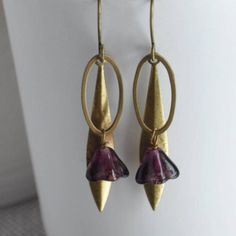 Purple Longleaf Bell Flower Earrings   artysmartyPurple Longleaf Bell Flower Earrings from ArtySmartyShop.com   Gorgeous antiqued brass and Czech glass dangly bell flower bead earrings on an elegant hook.These dainty hanging leaf earrings made from antiqued brass and a pretty purple bell flower Czech glass bead, are inspired by the Irish countryside and turned into a contemporary piece to wear into our Dublin studio where we handcraft each of our beautiful pieces.  #artysmartyshop #fashion… Leaf Earrings, Flower Earrings, Czech Glass Beads, Beaded Flowers, Dublin, Antique Brass, Earrings Handmade, Countryside, Irish