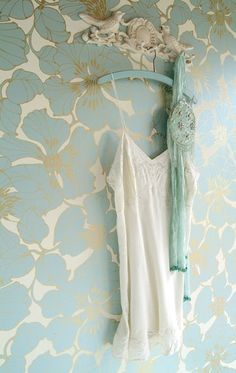 blue and gold floral wallpaper...would love this in a closet