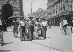 Four women pedestrians enjoying a day out, George Street, Sydney, 1890. The GPO is behind them.