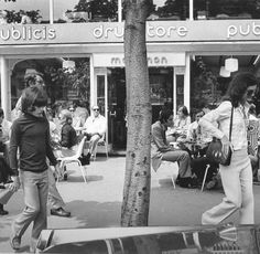 A mundane act like exiting a drug store in Paris meant that both this mother and son were the objects of curiosity, 1972.