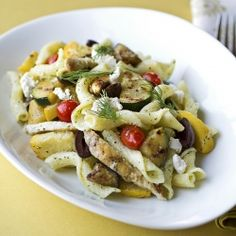 Warm Mediterranean Pasta Salad with Grilled Vegetables, Crumbled Feta Cheese and Grilled Chicken in a Creamy, Lemon-Dill Vinaigrette