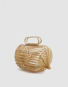 Sculptural handbag from CULT GAIA in bamboo. Top handles with carved logo detailing at interior. Curved base. Unlined. Collapsible. • Bamboo • Wipe clean