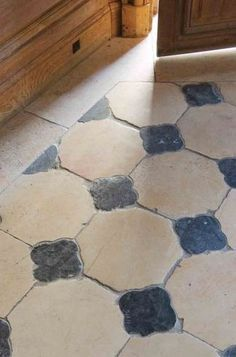 For some Old World inspiration, try this French petite granite cabachon and limestone floor