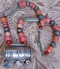 Old Berber Silver Korkoro with Chat Chat's & Coral https://www.etsy.com/listing/210946886/old-berber-silver-korkoro-with-chat BY INEKE HEMMINGA