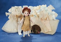 Wonderful German All-Bisque Doll with Rare Peach Shoes and Trousseau 1882